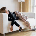 Bored woman lying in sofa